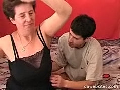 Young dude gets a lesson of hardcore fucking from a horny old lady