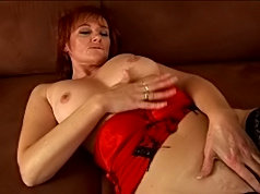 Mom with red hair fucks her own twat