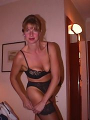 Toying milf babe in stockings and a cops uniform