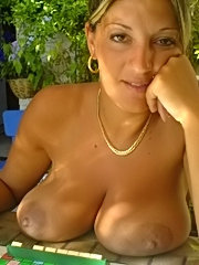 Zeek shows off her tender tits and ample ass before pleasuring her pussy