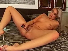Milf strips nude on the bed and penetrates her twat