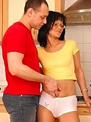 Two guys fucking naughty wife in the kitchen