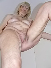 Horny granny teasing with tiny tits and gives blowjob