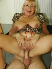 Naked mature lady licking her tits.