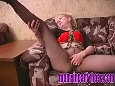 Experienced blondie in black pantyhose shows off