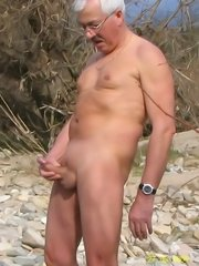 Old man wanks his cock when looking at the nude busty naturist women on wild beach