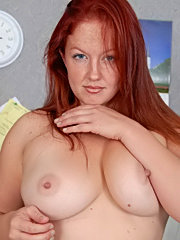 Mature blonde with silicone tits using electric sybian