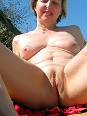 Fuckable mature maid with massive boobs willingly making happy younger guy