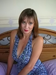 Big titted milf on her bed