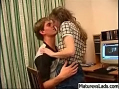 The guy was working with the computer in his room when his mature girlfriend came in to seduce him