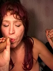 Older dame makes two hard dicks shoot the loads in her face