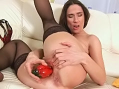Anilos chic stuffs her eager snatch with a red hot pepper