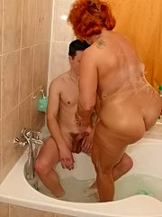 Fat redhead granny gets a fuck from younger lad while she washes herself in the tub