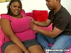 Hefty black hottie having her plump pussy drilled on the sofa