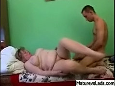 Fat mature lady gets a lot of pleasure by using her young boy-toy at full