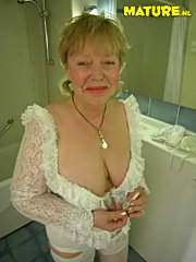 Granny gets her tits licked