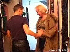 Horny mature pussy gets fucked by a young dick right in the corridor