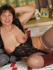 Mom caressing her hairy pussy with dildo