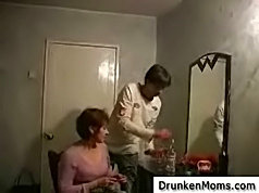 Mature whore had another drink and asked lad to follow her in the bedroom with just the perfect bed for fucking