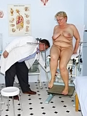 Old fat mature woman with glasses having pussy examined on gyno chair