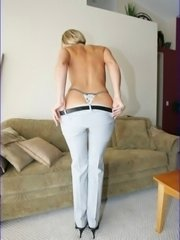 Hot blonde milf gets undressed and spreads her legs
