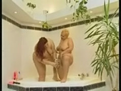 Two fat lesbians playing with double-headed dildo