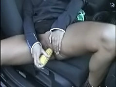 German wife playing with a corn dildo inside the car