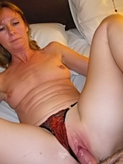 Playful girl next door massages lotion into her tits and pussy