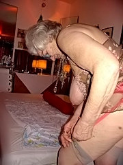 Plumper granny fondles her tits during sex