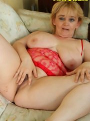 Busty older blonde takes a massive black cock in her ass!