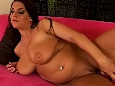 Big titty milf plugs her pussy with a dildo