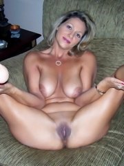 Big titted amateur milf momma showing her massive boobs