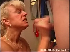 Milf gets a quickie with a younger guy at her door
