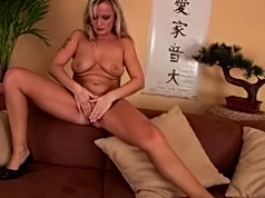 Milf sucks a dildo before ramming it into her pussy