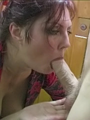 Sexy milf sucking two dicks and getting two loads on her face