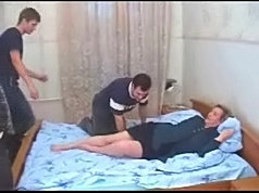 Lonely dame and her young fuckers have fun in bedroom