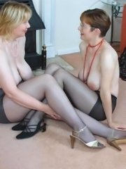 Two nyloned babes petting