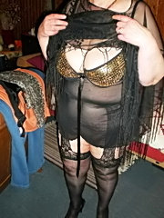 Fat housewife posing naked in the kitchen