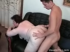Skinny young lad sinks his hard cock deep into a huge piece of milf ass