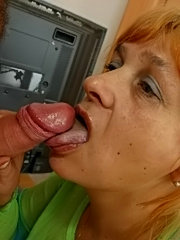 Business lady takes in mouth black and white cocks