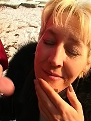 Blonde mommy sucking two dicks outdoors