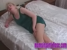 Sexed-up blonde lady plays with her pussy in pantyhose